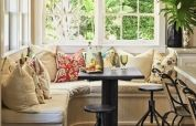 This window seat adds warmth to the space!! Best place for reading and spending some quality time with your beloved!! Add more cushions in the area and the place will look stunning!!