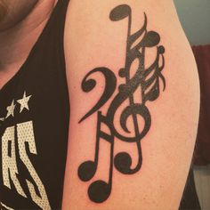 Music note tribal tattoo