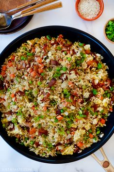 Take on the takeout with this easy recipe for One-Pan Bacon and Egg Fried Rice. justataste.com #recipes #friedrice #onepotdinners #onepandinners #copycatrestaurantrecipes #food #justatasterecipes