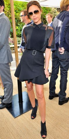 Beckham wore her eponymous line from the spring 2014 collection to an event, which featured a black sheer-and-paneled short-sleeve blouse tu...