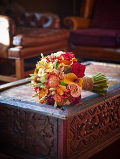 Fill your bouquet with fresh autumn flowers for your wedding occasion.