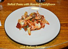 Baked Penne is layered with roasted cauliflower, Italian sausage, spinach, sauce, and cheeses.  #SundaySupper