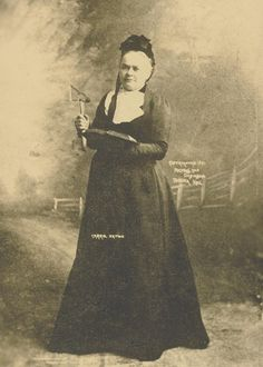 Portrait of Carry A. Nation   holding a hatchet and Bible...  Courtesy of the Kansas Historical Society