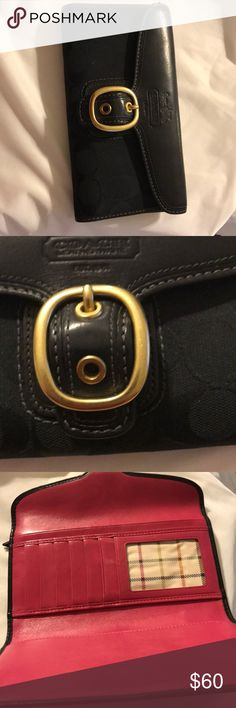 Excellent condition Coach wallet Excellent condition women's large wallet color black hardware is gold inside is pink no rips no tears no holes smoke free home Coach Bags Wallets