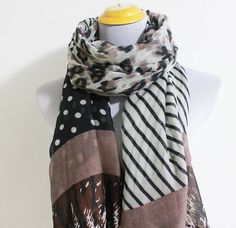 Hey, I found this really awesome Etsy listing at https://www.etsy.com/listing/164758359/taupe-leopard-and-color-block-scarf