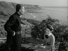 Rex Harrison and Gene Tierney in front yard
