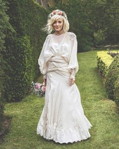 bride in a wrap overlay with long sleeves and floral crown