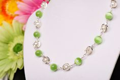 """Item 12004:  14"""" Necklace w/green cat's eye glass bead and glass pearl in silver cage with wrie wrapping. Lobster clasp - $19.00"""