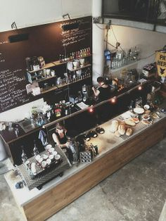 amazing cafe kitchen high ceiling chalk board coffee wood and granite
