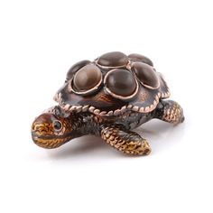"""""""Small Brown Turtle Gift Box Item No. KB00353A01 $19.59 This Faberge style trinket box is made to resemble a beautiful turtle. It features a heavy pewter base to prevent it from rolling over. Both the inside and the outside of this box are hand enameled."""""""