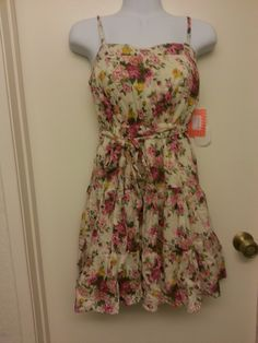 """NWT, Floral and cream, Size Small, Moon  Bust: 13"""" flat (with stretch, ruching on back)  Waist: 11""""-16"""" flat (with stretch, elastic waist with belt tie)  Length: 34"""" with adjustable straps  Materials: 100% cotton lining, 100% rayon self"""