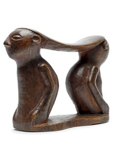 A Twa neckrest  Wood - 25 cm D.R. Congo A rare double figure neckrest, the Twa were nomadic hunters and the only pygmy group known to pro...