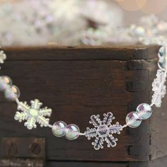 $4.99 Miniature Clear Iridescent Snowflake and Bead Garland