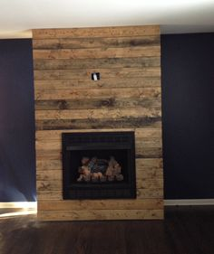how to create a diy reclaimed wood fireplace surround for less than 100 - Wood Wall Design Ideas