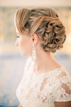 Romantic and classy wedding updo with soft curls