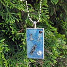 Calming Blue Jewelry Down by the Sea with Lighthouse and fish Resin Jewelry Pendant - Three Demensional wearble art necklace. $18.00, via Etsy.