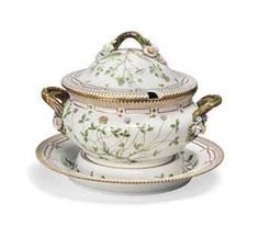 A Royal Copenhagen 'Flora Danica Two-handled Soup-fureen, cover and stand, 20th century, underglaze blue wave marks, green printed marks and painted numerals 20/3562 AND 20 3563 With branch handles terminating in flowers, painted with specimen floral sprays, within pink bead and gilt borders and serrated rims, titled in Latin script to the reverse, with Veronica persica Poir, Linnoea Borealis L., Triforlium fragiferum L. and Rubus villicaulis Köhl The stand 13¼ in. (33.6 cm.) wide