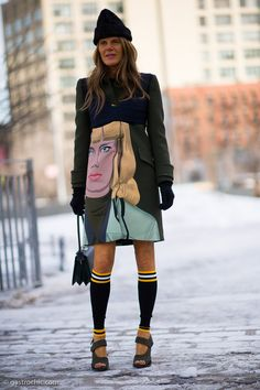 Making (fur) faces. Anna Dello Russo tying on another Prada confection at NYFW. Prada doing some serious action in the States.