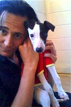 Tom and his puppy, who is wearing a little t-shirt. I'll just be over here having a fangirl seizure from the adorable.