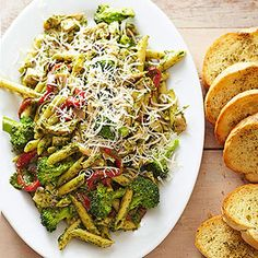 Purchased pesto and roast chicken help get this main-dish pasta on the table in 20 minutes. Broccoli cooks with the pasta and lends its fresh flavor.