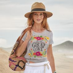 """GREAT LOVE TEE--A heartfelt mantra to see you through the day with floral graphics and a classic fit. Cotton/polyester. Machine wash. Imported. Sizes S to XL. Approx. 27""""L."""