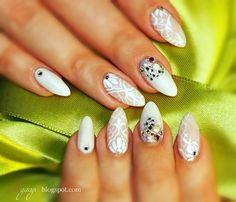 White nails with Swarovski crystals