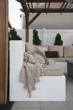 I'm sharing an update I made to our concrete outdoor sofa. It's amazing what a fresh coat of paint will do! Click through to see how I painted concrete and how the sofa is holding up. Backyard Seating, Outdoor Seating Areas, Garden Seating, Outdoor Spaces, Concrete Bench, Concrete Furniture, Garden Furniture, Urban Furniture, Concrete Fire Pits