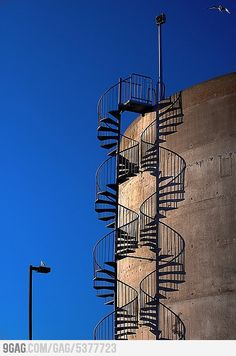 The stairs with their shadow look like DNA.