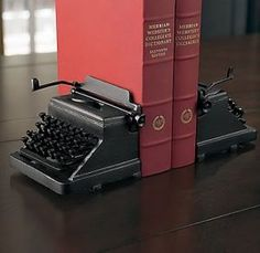 Typewriter bookends - how cute! So would love these for my desk.