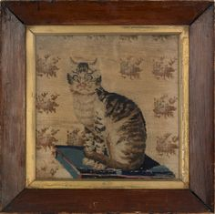 """Needlework of a cat seated on a pillow, early 19th c., 12"""" x 11 1/2"""