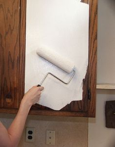 for the bathroom until our big remodel?  How to paint kitchen cabinets. This is the primer that will stick to anything.