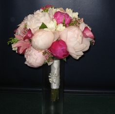 created with a variety of calla lilies, peonies, lilies, and other gorgeous flowers