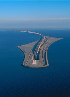 """s-h-e-e-r: """" Øresund Bridge """" is a combined railway and motorway bridge across the Øresund strait between Sweden and Denmark. The bridge runs nearly 8 kilometres (5 miles) from the Swedish coast to the artificial island Peberholm in the middle of the strait."""