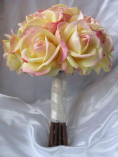 a dozen real touch yellow roses   http://www.etsy.com/listing/88668316/real-touch-rose-wedding-bridal-party