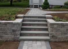 Learn more about Bahler Brothers custom stone and paver steps and get ideas for your next project in the Northern and Central Connecticut region. Backyard Retaining Walls, Retaining Wall Steps, Sloped Backyard, Sloped Garden, Backyard Patio, Retaining Wall Blocks, Concrete Retaining Walls, Front Walkway, Front Yard Landscaping