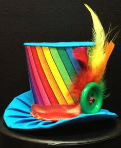 This adorable mini top hat is completely handmade and one of a kind. This would make great party hat or photo prop.    The hat is approximately 3
