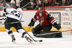 GLENDALE, AZ - DECEMBER 01: Trevor Lewis #22 of the Los Angeles Kings skates in with the puck for a shot on goalie Mike Smith #41 of the Arizona Coyotes during the third period at Gila River Arena on December 1, 2016 in Glendale, Arizona. (Photo by Norm Hall/NHLI via Getty Images)