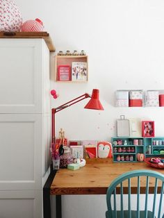 desk with teal and red accents
