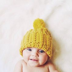 sweetest baby in yellow knit hat