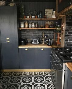 Küche Patterned floor tiles, dark subway tile backsplash, dark cabinets, wooden counter tops Vinyl G Interior Design Kitchen, Interior Design Living Room, Interior Livingroom, Black Kitchens, Home Kitchens, Kitchen Themes, Kitchen Decor, Kitchen Flooring, Kitchen Cabinets