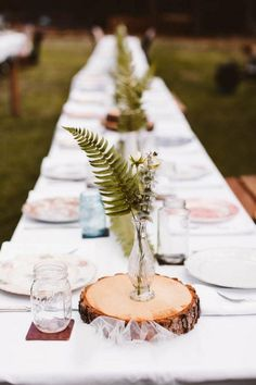 These tree slice centerpieces are subtly rustic and totally elegant | Image by Allison Harp
