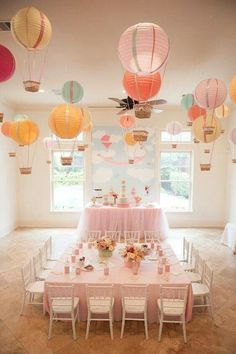 """I love the hot air balloon idea. Create one stunning eye-catching display by hanging paper lantern hot air balloons from the ceiling. This is a great idea for an """"Up In The Air"""" baby shower or birthday party! Idee Baby Shower, Baby Shower Themes, Shower Ideas, Babyshower Themes For Girls, Baby Shower Table Set Up, Babyshower Decor, Baby Shower Chair, Baby Decor, Baby Shower Balloons"""