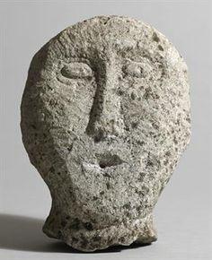 Lot 1 - Circa 500BC to 500AD Iron Age. Irish stone head. Limestone; broken at the base, lower part of mouth