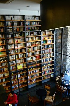 Every book would be individually picked to a have a reference to a design of clothing.  book cafe