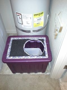 I saw a litter box here on Pinterest and thought I would give it a try.  The directions were simple and easy to follow. I found an 18 gallon purple tote at Target I liked for $7.99, there was already an old door mat in the garage that I used to cover the lid after I cut out a hole so the cat to go in and out. I also used a paisley print duct tape that I found at Michaels to go along the edges of the rug.