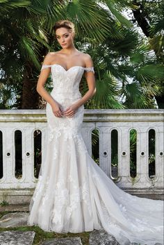 This Venice lace and Point D'esprit fit and flare gown is the epitome of timeless romance. The lace straps at the neckline are detachable. The fitted silhouette features allover lace details and a chapel length train.