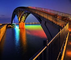 Xiying Rainbow Bridge: Penghu, Taiwan By day, nothing appears especially remarkable about the Xiying Rainbow Bridge. But at night it transforms into a double rainbow the likes of which Internet meme celebrity Bear Vasquez can only dream. The neon arch of this pedestrian bridge is reflected in the shimmering lagoon, creating a double arch of intense color.