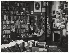 James Joyce is often found here in the famous little bookshop of Sylvia Beach, Shakespeare and Company. Here we see him having a chat with Sylvia Beach, who published the First Edition of Ulysses in her shop, and Adrienne Monnier publisher of the French translation of Ulysses.