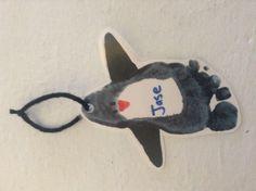 Foot print penguin ornament.