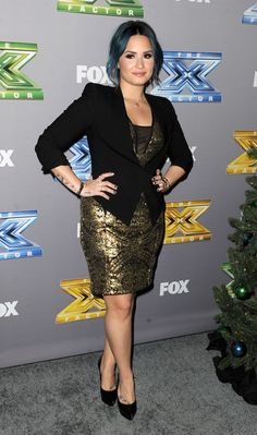 Demi Lovato dressed down her sequins. the dress is beautiful except in my opinion, it just does not look good on her when she has blue hair